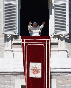 Pope Benedict XVI waves as he leads the Sunday angelus prayer in Saint Peter Square at the Vatican on Feb. 10, 2013.