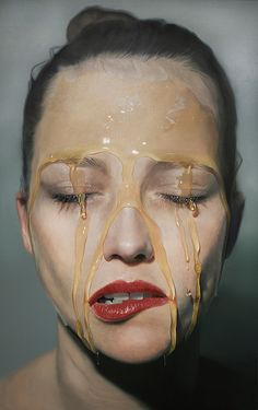 German artist Mike Dargas paints hyperrealistic works of women's' faces covered in honey. The luscious, visceral images are up-close, frontal portraits that show the gentle creases in skin as well as the viscous glare on the liquid as it travels down their face. It's fascinating to