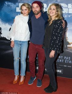 Happy to be there: Hugging and smiling as they posed for photos, the pair were joined by Alysson's actor boyfriend Guillaume Gouix - who is one of the stars of the French thriller film