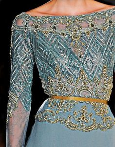Ellie Saab... such delicate and intricate beading...the colour is also so vibrant and feminine.