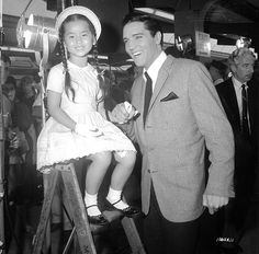 Elvis on the set of the movie It happened at the world's fair september 5 1962 between takes with his Young co-star.