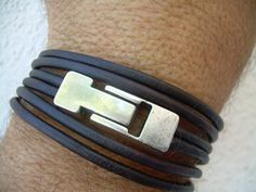 Hey, I found this really awesome Etsy listing at http://www.etsy.com/listing/111147135/leather-bracelet-triple-wrap-industrial