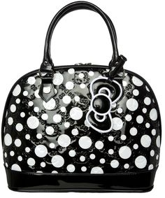 HELLO KITTY POLKA DOT PURSE BLACK/WHITE    Look darling in dots with Hello Kitty! This over-sized purse features an all over white polka dot pattern on a shiny vinyl bag featuring embossed bows & Hello Kitty faces, sturdy base with circular metal feet, double zipper pulls & removable bow.    $68.00