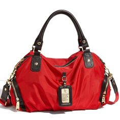 """Red JPK Paris75 Satchel  This Red JPK Paris 75 top handle satchel w/detachable strap & gold hardware is a showstopper!  Perfect bag for weekend fun, shopping or travel. Can be a shoulder bag, hand or cross body. Quick storage w/ zip back pocket & one on each side, 1 inner full zip & 2 multi. Fab carryall with a gorgeous rose print lining. Top handle has minor wear (pic 4). Vibrant color, shiny hardware & logo details truly make this a standout wardrobe addition. Strap's 48"""" fully extended…"""