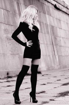Short black dress, knee-high socks, heels