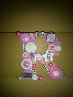 button letter plaque,created for a teenager that loves music so decorated with music charms.