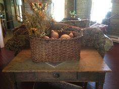 Large antique basket filled with florals and gourds in our sitting room.  www.finecountrylivingprimitives.com