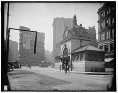 Adams Square Station c1906. Background tall Ames building (masonry bearing - no steel skeleton) and statue of Sam Adams. Statue now located in front of Faneuil Hall.