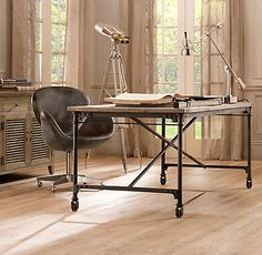 Flatiron Desk | Restoration Hardware -- cool placement of storage behind desk (also, I think you can get the knock-off of this desk at World Market).