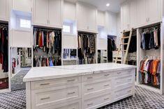 726 Frandora Lane Houston, TX 77024: Photo Enormous sized closet offers an abundance of white toned built-ins, custom marble prep table, display mirror, and custom lighting throughout.