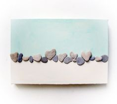 Ok, I am SO going scouting for heart shaped beach rocks now! How simple and cute!