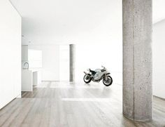 No bachelors pad would be complete without a sports bike in the kitchen. #installedbyamber #amberflooring #hardwoodfloors #woodwork #wood #art #design #home #interiordesign #modern #clean #stylish #floors #flooring de amber_flooring