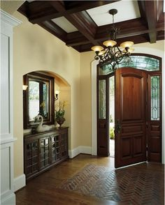 brick foyer | features in this entryway. Love the brick inset. #entryways #foyers ...