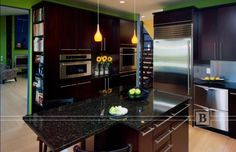 Dark stained cabinets with stainless steel appliances