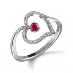 Designed in delicate white gold, this ring brings together a swirl of diamonds and love. The Lovestruck Bract Ring is centred on a beautiful, diamond-edged heart with a large ruby capturing all the attention.