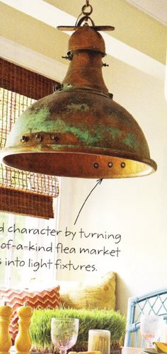 cool light fixture from flea market finds. via a BHG publication, I think.