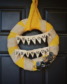 """For the blue house ;-) // Yellow Burlap """"Welcome"""" Wreath, 37$ via Etsy"""