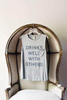 Drinks well with others. I need that shirt!