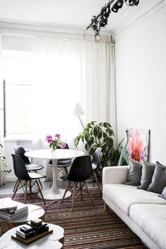 Ikea 'Docksta' tulipe table in eclectic home