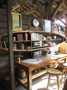 A simple desk, a simple office; canoe shelving.... What a fantastic idea for old canoe
