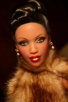 Whoever did her make-up needs to work for Mattel cause, Barbie's make-up doesn't even come close to this.