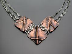 Fold form copper pendant with silver jump ring design