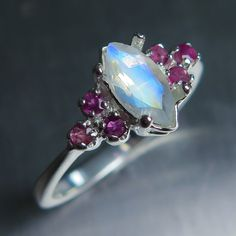 0.60cts Natural Rainbow Moonstone & red rubies Sterling by EVGAD  This would be gorgeous with sapphire accents.