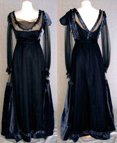 Evening gown, 1915. Empire-waisted, long-sleeved gown in black tulle. Charcoal velvet sleeve caps and large semi-circular side hem gores. Trimmed with gunmetal bugle-bead bands. Black satin under-dress. Augusta Auctions