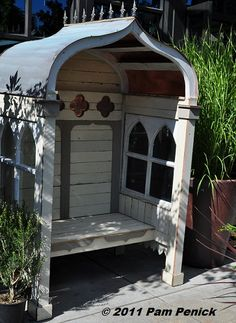 LOVE this whimsical, enclosed garden bench made out of architectural salvage