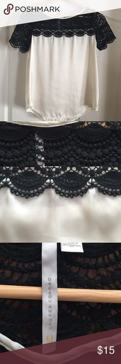 Ivory and Black Lauren Conrad blouse Ivory and Black Lauren Conrad blouse. Cotton upper and polyester bottom (satin finish) picture may look a little white but bottom is  more ivory color. Tops Blouses