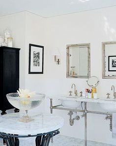 Stark and elegant bathroom design idea brings in chrome pipework under the sink to provide additional light and visual interest.   This is from #MarthaStewart designer Kevin Sharkey.
