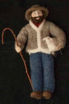 The Shepherd is an original art doll designed and sculpted with naturally colored and hand dyed wool by Marie Schmidt in her Durakai Fiber Art studio. The doll was inspired by my shepherd who can often be found carrying a lamb into the barn during lambing season. Needle felting