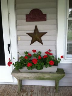 Front porch bench, long flower container, and wall art brings together a nice look. - My Sunny Gardens