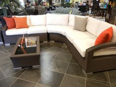 Cream Curve Shaped Letter L Cream Leather Sofa With Orange Pillows Brown  Wooden Framed Glass Table Brown Floor Furniture Stores In San Diego