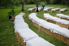 Great idea for a country wedding. Love that the hay bales are covered with cloth!