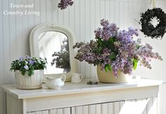 Lilacs in a white kitchen.  Town and Country Living blog