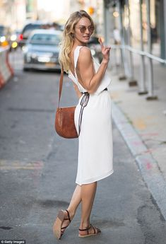 Candice Swanepoel stopped traffic in her sexy backless gown after walking for DVF http://dailym.ai/1pIf0eT #NYFW