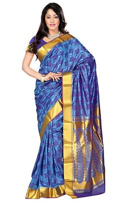 Adorn yourself in the most ethereal manner as you don this printed sari in blue color art silk. The lovely printed work across saree is awe-inspiring. #wonderfulsaris #charminglooksari #printedsareecollection
