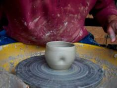 this is a video of me throwing some yunomi drinking cups in white stoneware for a raku firing next week the clay body is valentines white grogged. which alow...