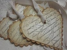 Victorian-style paper heart hangers made from salvaged & stained vintage book pages or lett
