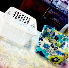 DIY Fabric Covered Bins from the dollar store...like the idea of this, but not how she finished the inside of the basket. i would have to tweek this a little bit