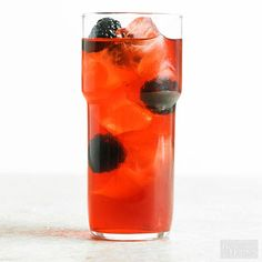 A splash of sparkling lemonade gives this blackberry-bourbon drink recipe its bubbly appeal. Be sure to pour the syrup in last for dramatic color in every glass, then pop in a few berries for garnish./