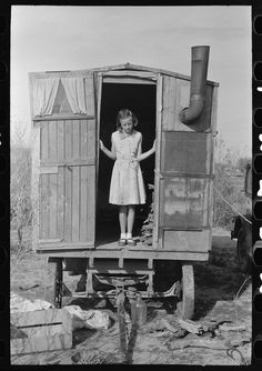 Untitled photo, possibly related to: Daughter of migrant in doorway of trailer, Sebastin, Texas. 1939 Feb. Library of Congress.