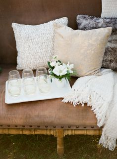 cozy conversation spot #pillow  Photography: Loft Photographie LLC - loftphotographie.com  Read More: http://www.stylemepretty.com/2014/02/28/cozy-outdoor-wedding-inspiration/