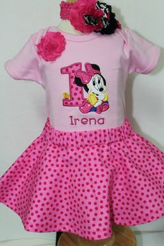 This Personalized Baby Minnie Mouse birthday outfit comes complete with pink onesie, Hot pink polka dot twirl skirt, and a matching headband.  The bodysuit is appliqued with baby Minnie Mouse sitting by a number one appliqued in the same fabric as the twirl skirt.  She has a little cupcake sitting by her also.  The shirt can be personalized with your child's name.  I do not charge extra for this.  Just add your child's name in the notes on your order.       You may request a tutu in matching…