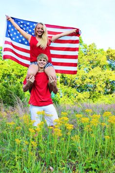 Couples pictures. Photography. Posing. Posing ideas. Couples pictures with flag. Red white and blue. Memorial Day. Fourth of July. Flag. American flag.  Carrie McClellan Photography. Field. Flowers.