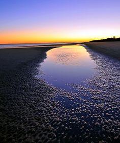 The day's last light settles across the beach of Hilton Head Island, South Carolina