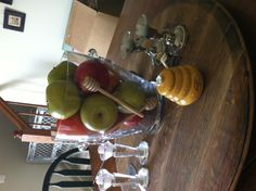 Rosh Hashana Centerpiece (Vase $7.49, Faux Apples $10, Wooden Honey Drippers $1.25/each)