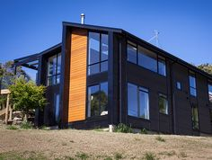 Dimond Corrugute Cladding Colorcote Magnaflow in Black Location: Waitakere, Auckland Steel Roofing, Auckland, Cladding, Garage Doors, Multi Story Building, Shed, Iron, Outdoor Structures, Colour Black