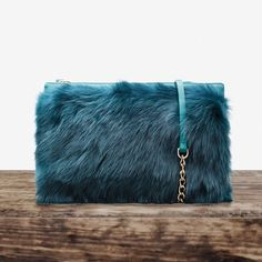 "✨HOST PICK✨Üterque Toscana Shearling Blue Clutch. Clutch bag from Üterque, Zara's upscale brand.  Made in high quality Todcana shearling combined with lambskin. Zip closure and optional cross-body chain strap. Single compartment with a zipped side pocket.   Comes with dust bag.                                              Approximate measures: 7"" x  10"".                            Color as in the catalog's photo. Üterque Bags Clutches & Wristlets"